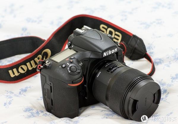 谁能推荐一款单反镜头?相机:尼康d3000,要求 焦外景物