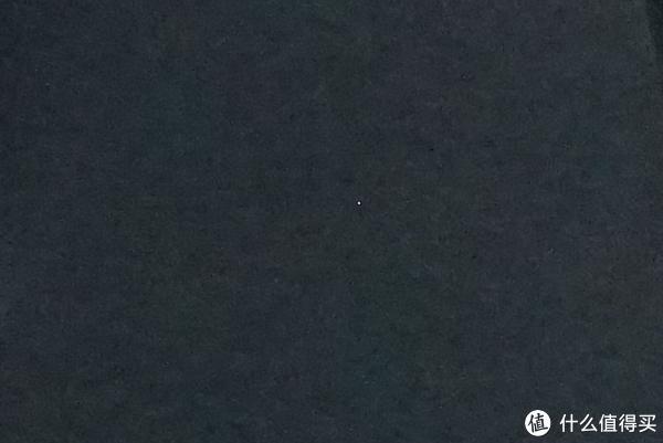 拍的照片局部放大,显示一个白色亮点