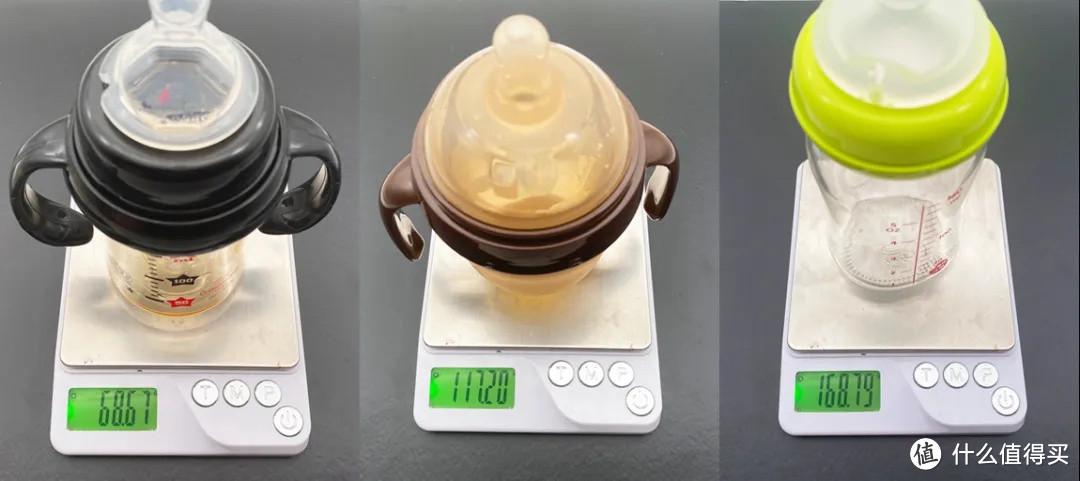 体积150毫升左右的奶瓶,从左到右依次为:PPSU塑料、硅胶、玻璃,玻璃最重